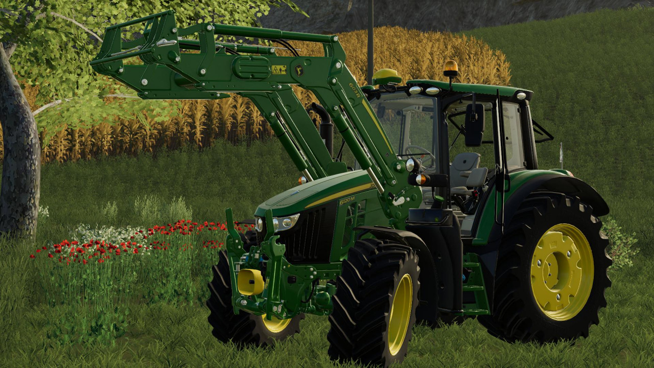 John Deere 6M Series with 603R front loader
