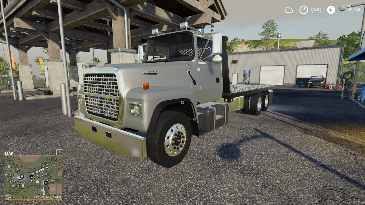 Ford L8000 flatbed/AR truck